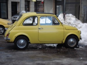 Yellow old Fiat 500 in the snow